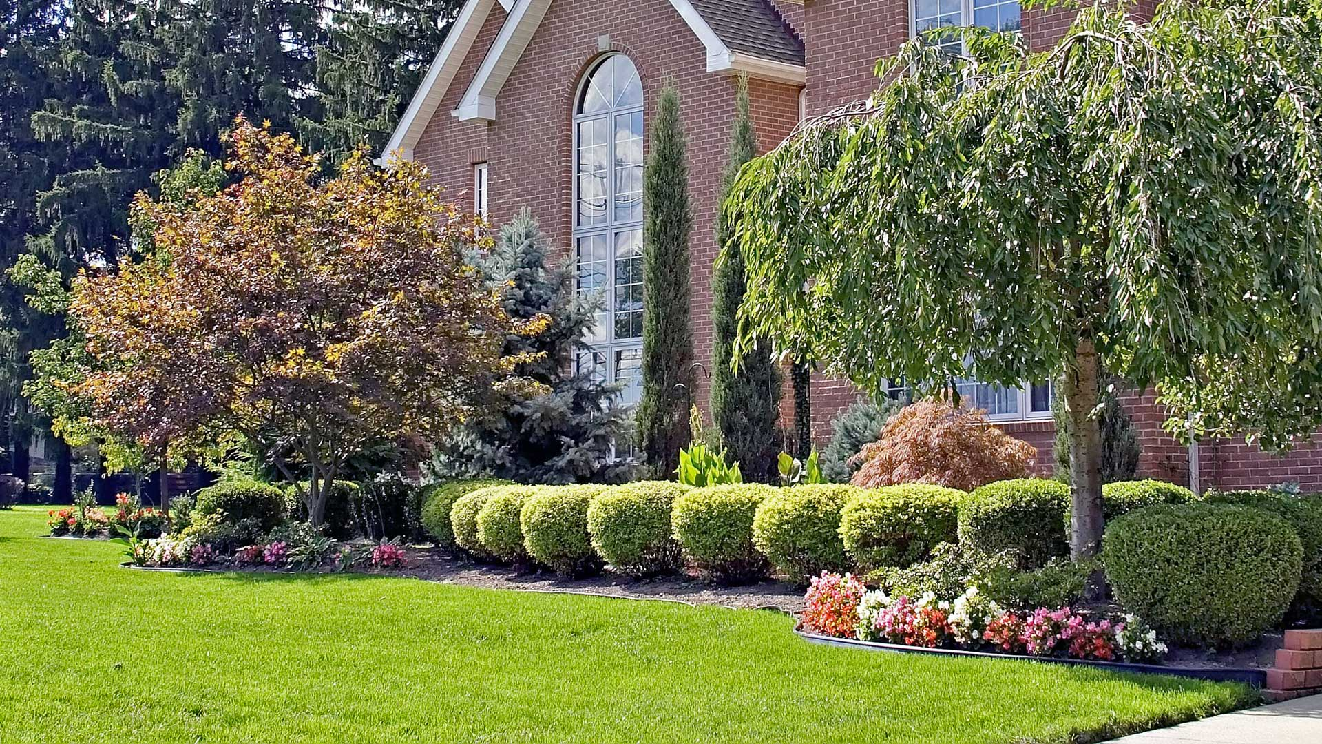 Professional landscaping in front of a Highland home.