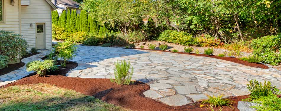 Recently installed flagstone patio and walkway in the backyard of a home in Highland, NY.